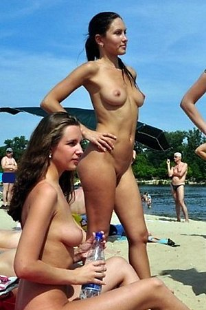 without complexes female nude chicks takes off  their panties at beach among men