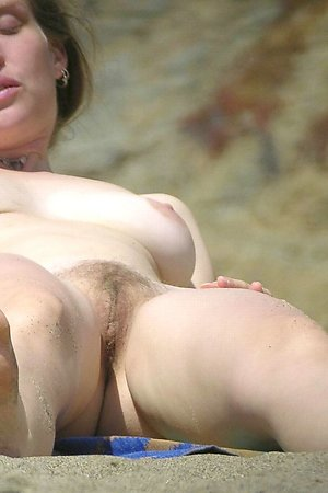 Tanned shaved pussy at nudist beach