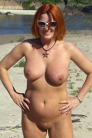 Pure mature naturists on a nudist beach