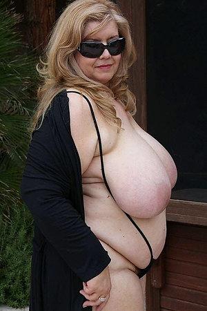 Huge breasted mature naturists