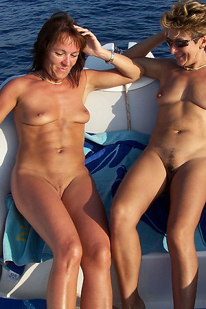 Nudist mature dames having nude boating