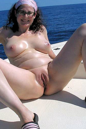 Sexy nudist girls spreads legs on the beach