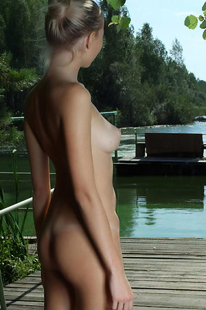 Naturists of various age on lake pier