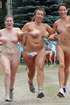 Old and young nudists playing sport games