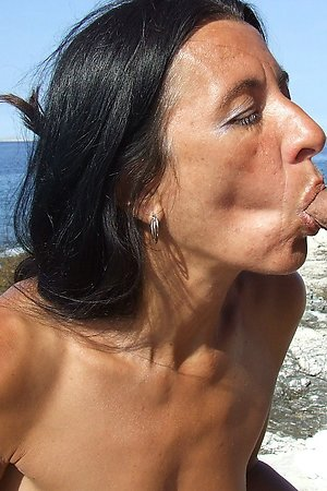 Sexually attractive sexy girls fucks on a nude beach