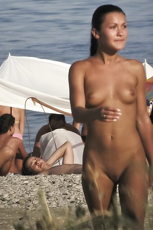 uncomplexed nudist babes takes off  their panties on a bare beach