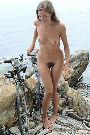 shapely young bitches sunbathes without panties among nudists