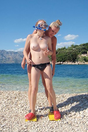 liberated young nudists gets warm for her ass at European beach