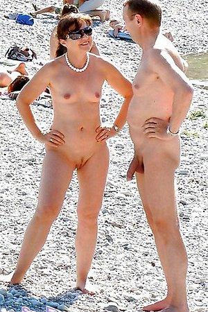 Sexy nudists on beach photos