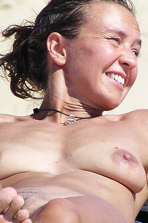 Nudist girl on nude beach with hot pussy - series of shots