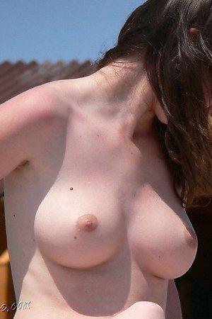 Spread legs on a nude beach