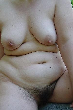 Fat mature nudist women over 40 taking a sun bath on beach