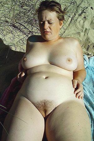 Chubby mature dames sunbathing on a nudist beach