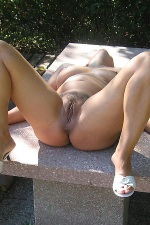 Mature nudists showing pussy on their backyard