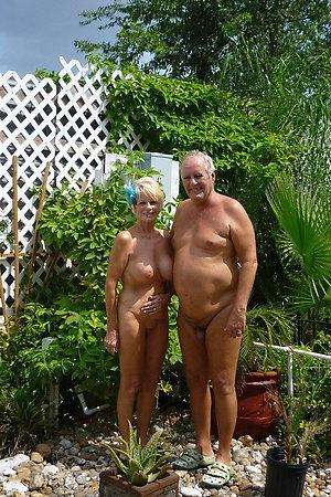 Nudist grandmas posing near their houses