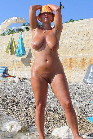Mature naturists on nudist beach