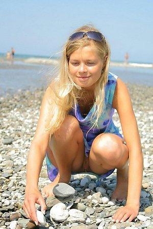 interesting nudist babes lie sunbathing naked at the beach