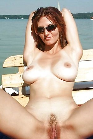 Nude beach - spread legs and close up nudist pussy video and pictures