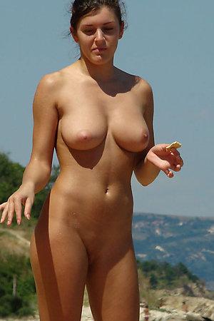 Naked babes sunbathing on the public beach