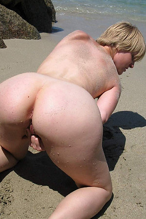 Naturist women photographed with visible assholes