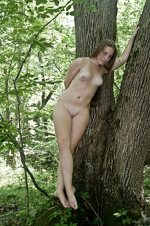 Their first nude outdoor photosession in a trees