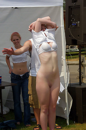 Girls undressing for their first nudist experience
