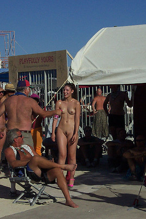 Many naturists of various age on beach