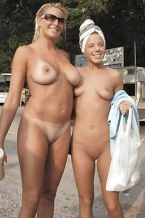 Naked mature moms with young girls in nature