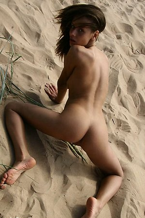 dissolute young nymphomaniac fully exposed at beach among men