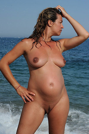 Nudist pregnant girls posing naked for camera