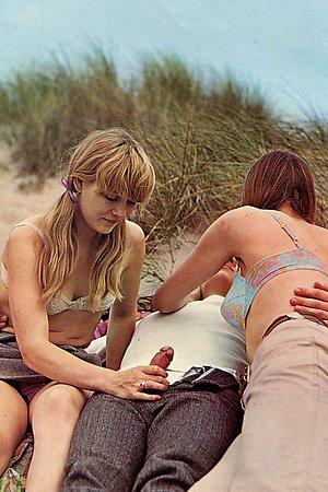Agitated nudist babes fucking hard at a wild beaches