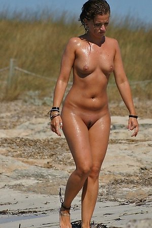 Always fresh photos about small tits, tanned body, shaved  pussy at nude beach