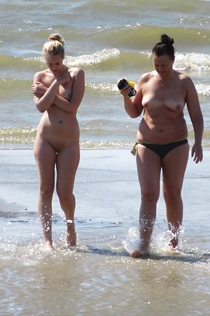 a lot of tanned body, sexy nude woman, shaved  pussy at nude beach